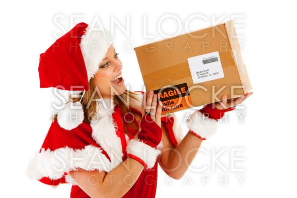 Christmas: Santa Girl with Parcel Stock Photography Content by Sean Locke