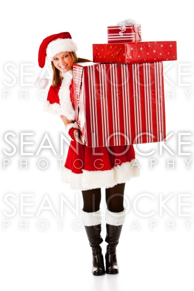 Christmas: Santa Girl with Stack of Gifts Stock Photography Content by Sean Locke