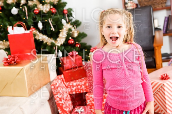 Christmas: Very Excited Little Girl Stock Photography Content by Sean Locke