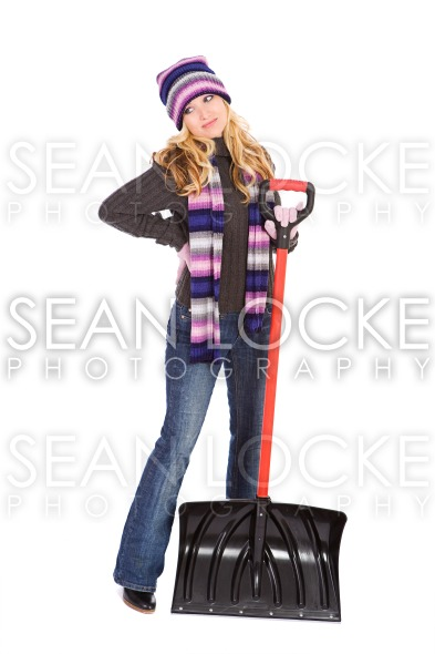 Winter: Woman Has Back Pain From Shoveling Stock Photography Content by Sean Locke