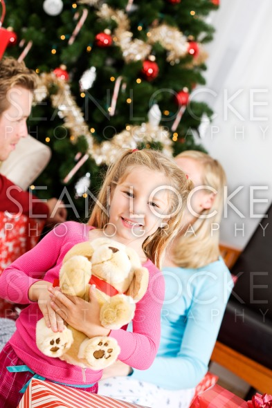 Christmas: Girl Gets Stuffed Dog for Christmas Stock Photography Content by Sean Locke
