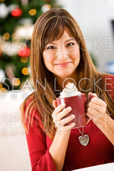 Christmas: Woman Holding Mug of Cocoa Stock Photography Content by Sean Locke