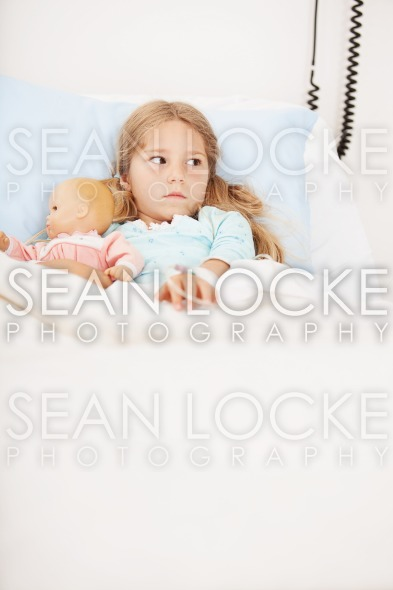 Hospital: Little Girl Afraid in Hospital Bed Stock Photography Content by Sean Locke