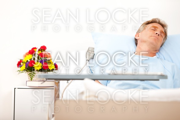 Hospital: Male Patient in Hospital Bed Stock Photography Content by Sean Locke