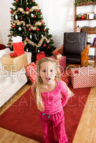 Christmas: Girl Excited on Christmas Morning Stock Photography Content by Sean Locke