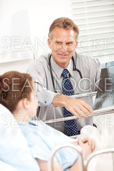 Hospital: Doctor Reviewing Xray with Patient Stock Photography Content by Sean Locke