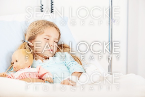 Hospital: Girl Sleeps With IV Drip Stock Photography Content by Sean Locke