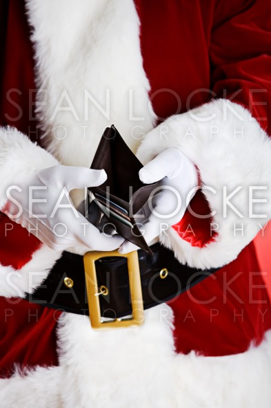 Santa: Showing Empty Wallet Stock Photography Content by Sean Locke