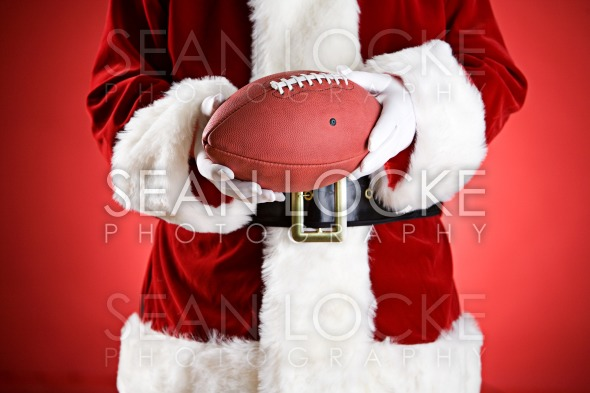 Santa: Holding An American Football Stock Photography Content by Sean Locke