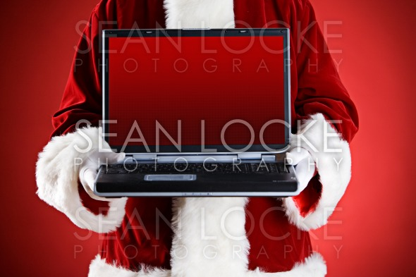 Santa: Holding A Laptop With Blank Screen Stock Photography Content by Sean Locke