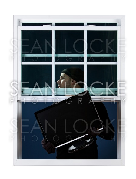 Burglar: Stealing a Television Set Stock Photography Content by Sean Locke