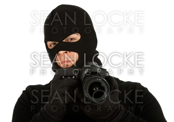 Burglar: Photographer Criminal Looks to Camera Stock Photography Content by Sean Locke