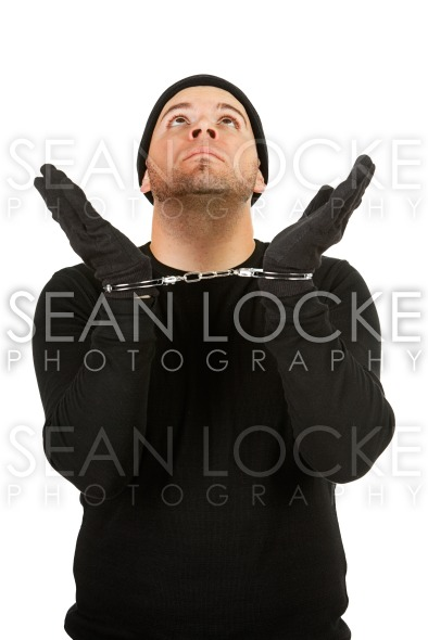 Burglar: Robber Wearing Handcuffs Stock Photography Content by Sean Locke