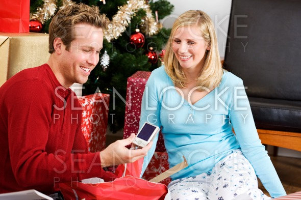 Christmas: Man Gets New Camera For Christmas Stock Photography Content by Sean Locke