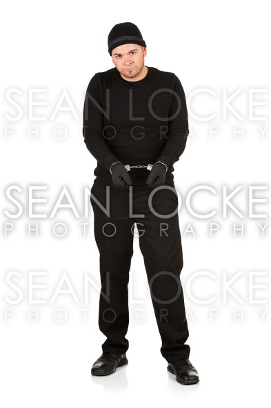 Burglar: Wearing Handcuffs Stock Photography Content by Sean Locke