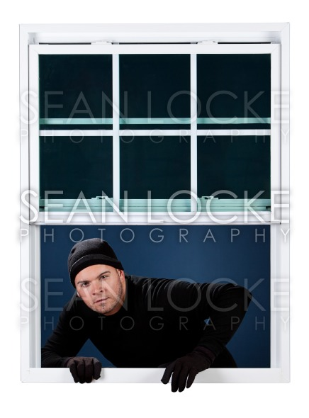 Burglar: Coming Into Window Stock Photography Content by Sean Locke