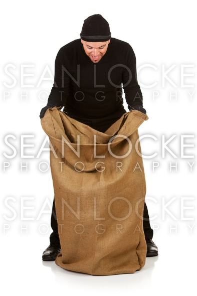 Burglar: Looking into Sack of Stolen Goods Stock Photography Content by Sean Locke