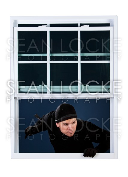 Burglar: Coming in an Open Window Stock Photography Content by Sean Locke