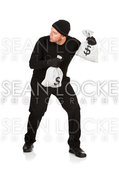 Burglar: Hears Sound Over Shoulder Stock Photography Content by Sean Locke