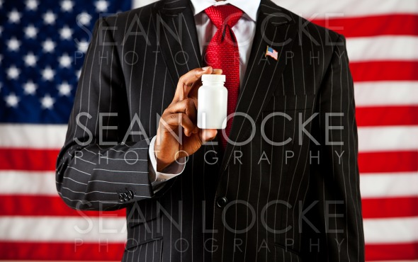 Politician: Holding a Blank Medicine Bottle Stock Photography Content by Sean Locke