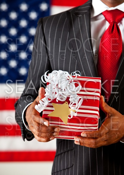 Politician: Holding a Christmas Present Stock Photography Content by Sean Locke