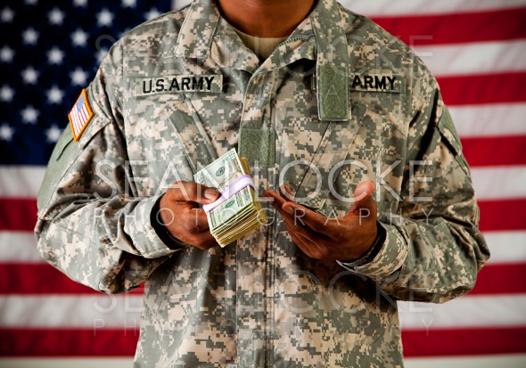 Soldier: Holding Stack of Money Stock Photography Content by Sean Locke