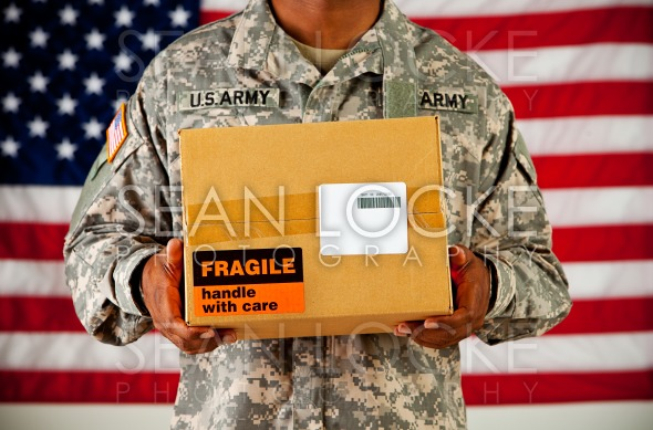 Soldier: Man Receives Package in Mail Stock Photography Content by Sean Locke