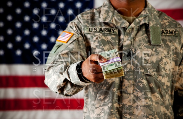 Soldier: Holding Out Cash Stock Photography Content by Sean Locke