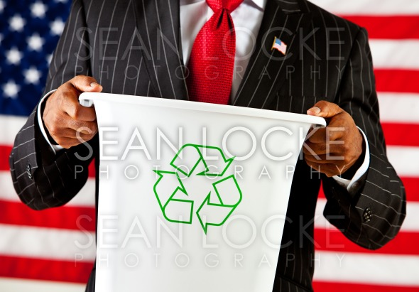Politician: Holding Recycle Bin Stock Photography Content by Sean Locke