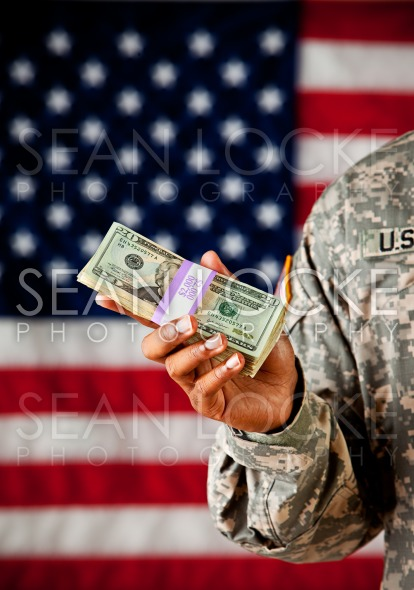 Soldier: Man Holding Stack of Cash Stock Photography Content by Sean Locke