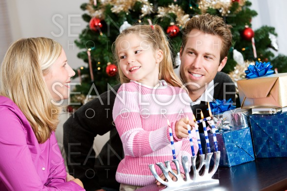 Holidays: Fun Family Time Lighting Menorah Stock Photography Content by Sean Locke