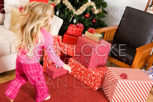 Christmas: Girl Runs to Presents Christmas Morning Stock Photography Content by Sean Locke