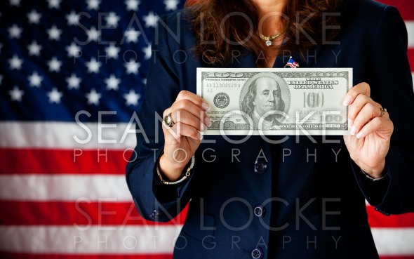 Politician: Holding a Large Hundred Dollar Bill Stock Photography Content by Sean Locke