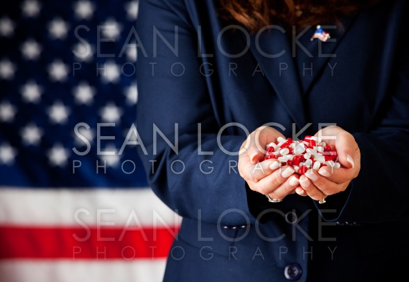Politician: Handful of Medicine Capsules Stock Photography Content by Sean Locke