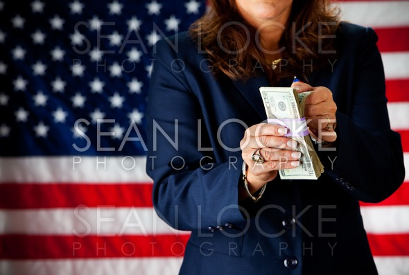 Politician: Counting Stack of Money Stock Photography Content by Sean Locke