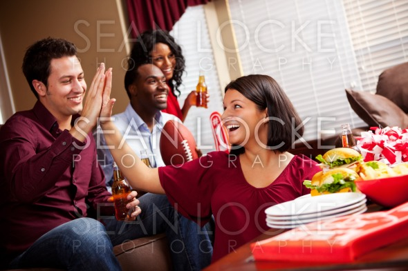 Football: Girl High Fives Friend During Game Stock Photography Content by Sean Locke