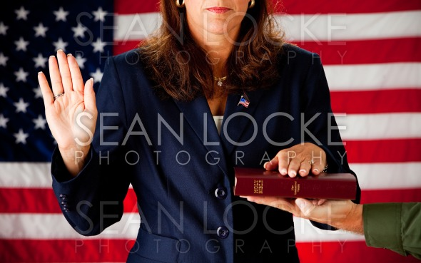 Politician: Woman Taking an Oath on the Bible Stock Photography Content by Sean Locke