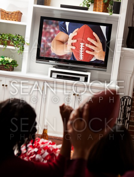 Football: Fans Cheer for Game on Television Stock Photography Content by Sean Locke