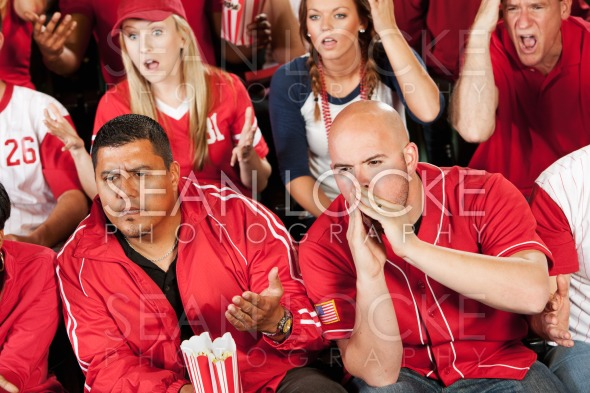 Fans: Fans Boo a Play on the Field Stock Photography Content by Sean Locke