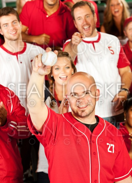 Fans: Fan Shows off Caught Ball Stock Photography Content by Sean Locke