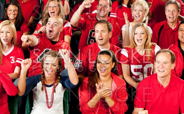 Fans: Football Fans Watch Exciting Game Stock Photography Content by Sean Locke