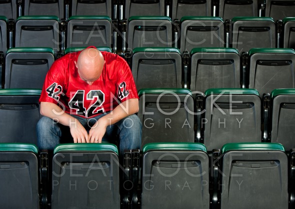 Fans: Lonely Man Disappointed After Football Loss Stock Photography Content by Sean Locke