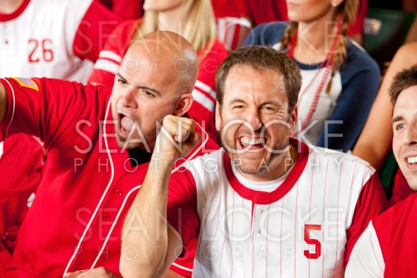 Fans: Pumped Up Baseball Fan Cheers to Camera Stock Photography Content by Sean Locke