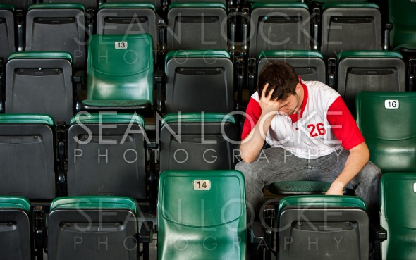 Fans: Man Sits Alone After Losing Stock Photography Content by Sean Locke