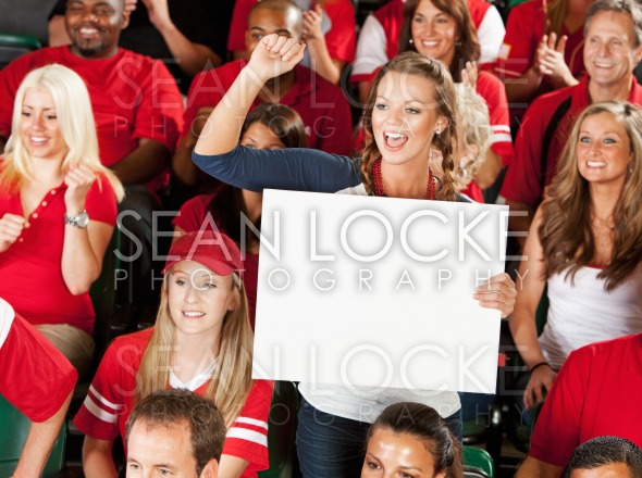 Fans: Woman Cheers for Team with Blank Sign Stock Photography Content by Sean Locke