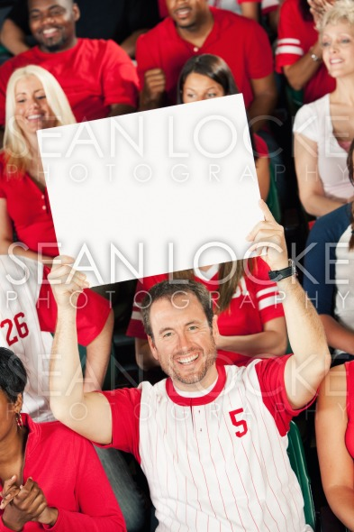 Fans: Fan Holds Up Blank Sign Stock Photography Content by Sean Locke