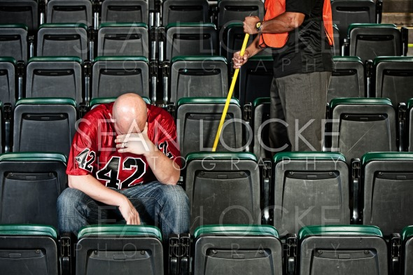 Fans: Upset Football Fan After Game Stock Photography Content by Sean Locke