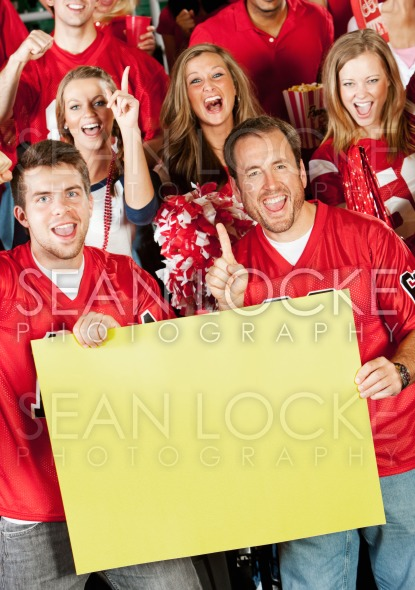 Fans: Holding Up a Yellow Sign Stock Photography Content by Sean Locke