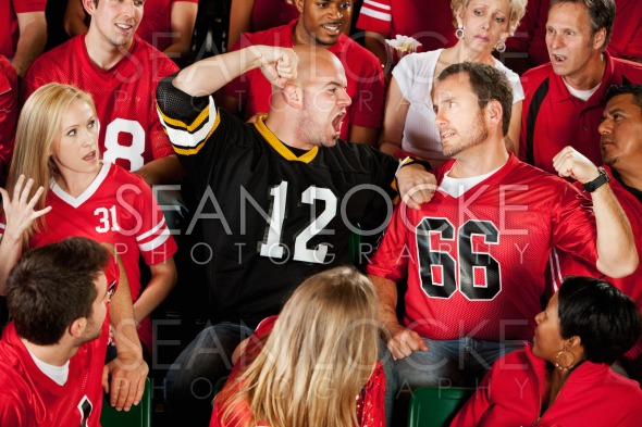Fans: Fans of Opposing Team Get in a Fight Stock Photography Content by Sean Locke
