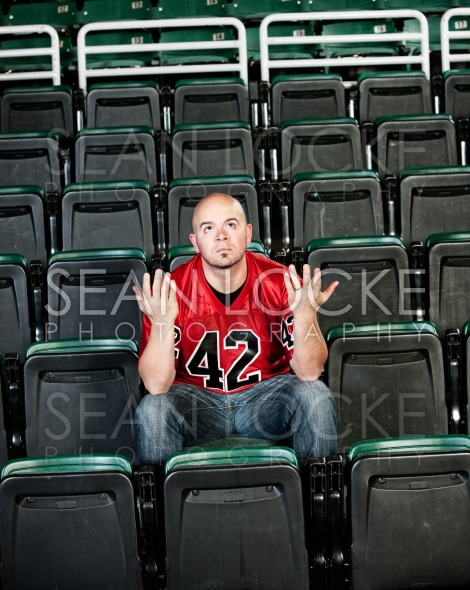 Fans: Lonely Fan Unsure of Why Team Lost Stock Photography Content by Sean Locke